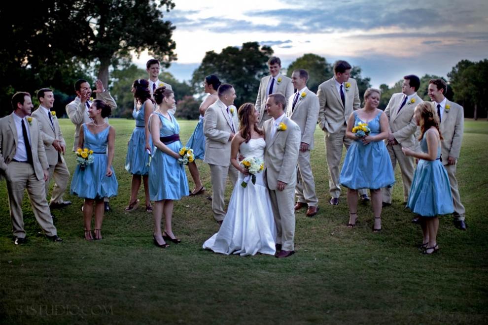 wedding party pose randomly mixed golf course