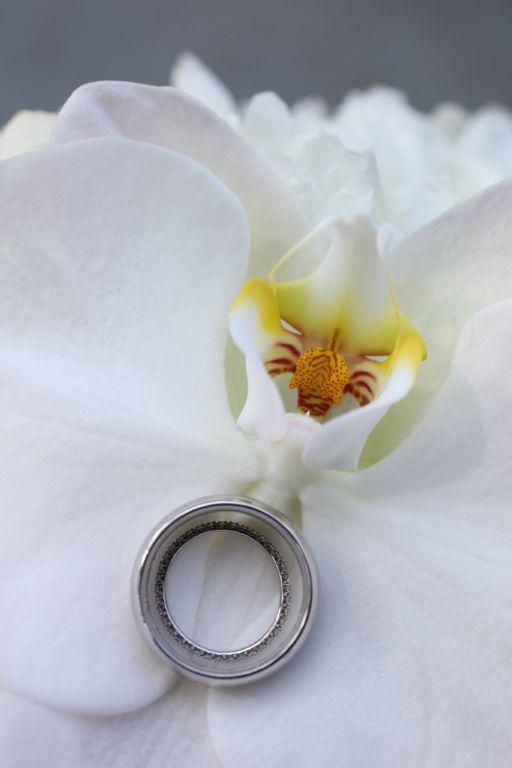 wedding ring on white flower