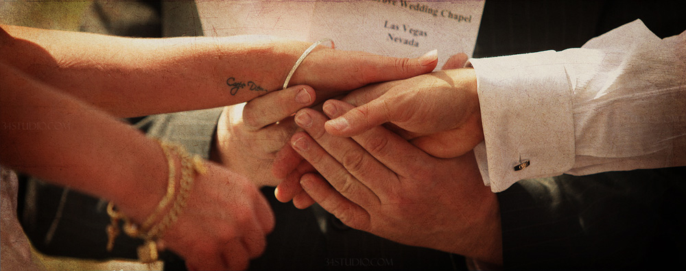 close up shot of groom holding brides hand and wedding vows