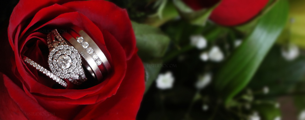 wedding rings engagement rings and wedding bands on a red rose